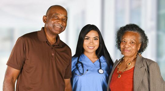 caregiver and seniors smiling
