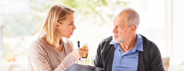 caregiver talking to the senior man